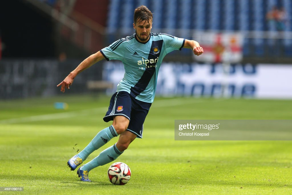 Carl Jenkinson of West Ham United runs with the ball during the match between FC Malaga and West Ham United as part of the Schalke 04 Cup Day at Veltins-Arena on August 3, 2014 in Gelsenkirchen, Germany.