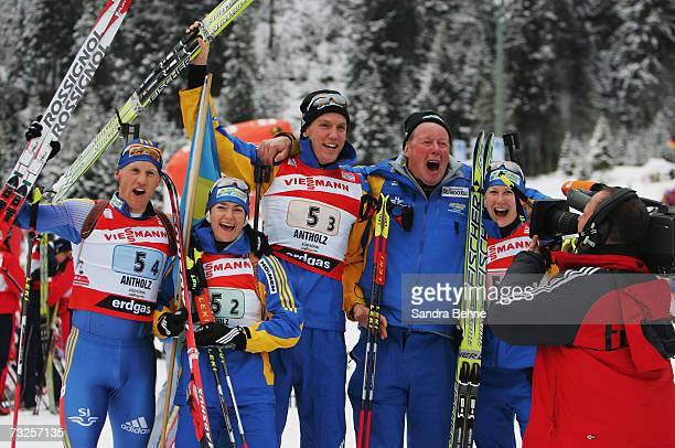 Carl Johan Bergman Anna Carin Olofsson Bjoern Ferry coach Wolfgang Pichler and Helena Jonsson of Sweden celebrate winning the gold medal of the Mixed...