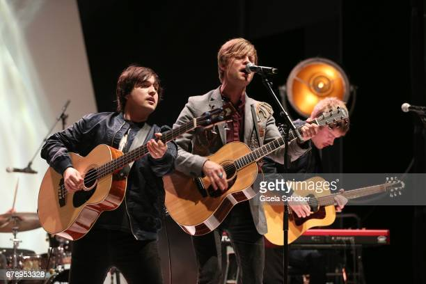 Carl Johan Fogelklou Bjoern Dixgard and Jens Siverstedt of the band Mando Diao perform during the ABOUT YOU AWARDS at the Mehr Theater in Hamburg on...