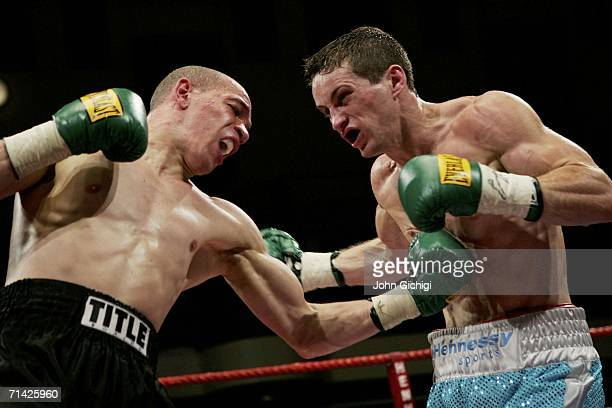 Carl Johanneson connects with a body shot against Billy Corcoran during the British Super Featherweight fight at York Hall July 12 2006 in London...