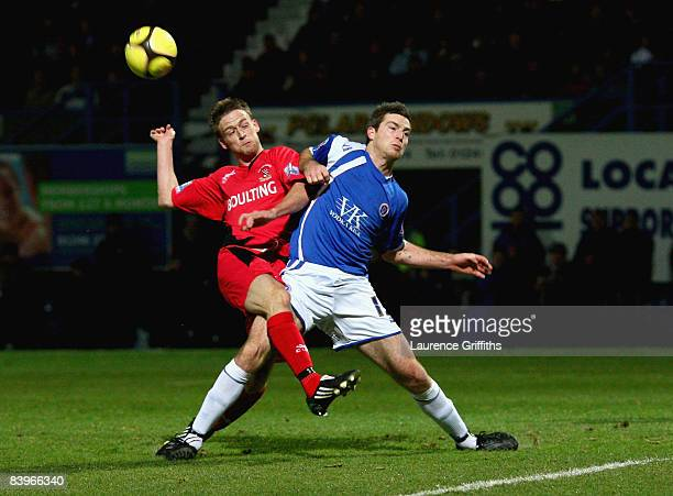 Carl Lamb of Droylsden has his shot blocked by Aaron Downes of Chesterfield during the FA Cup Second Round Match between Chesterfield and Droylsden...