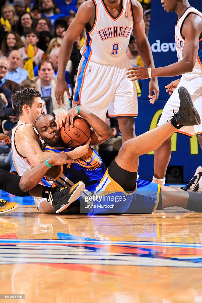 Carl Landry #7 of the Golden State Warriors fights for a loose ball against Nick Collison #4 of the Oklahoma City Thunder on February 6, 2013 at the Chesapeake Energy Arena in Oklahoma City, Oklahoma.