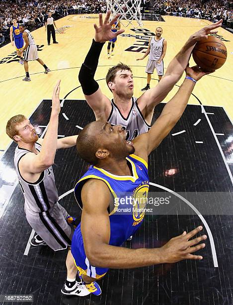 Carl Landry of the Golden State Warriors jumps for a rebound against Tiago Splitter of the San Antonio Spurs during Game Five of the Western...