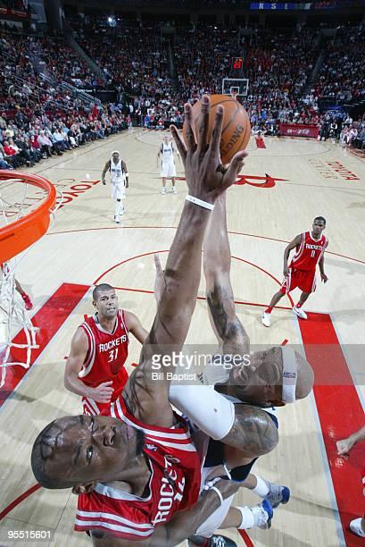 Carl Landry of the Houston Rockets blocks Erick Dampier of the Dallas Mavericks on December 31 2009 at the Toyota Center in Houston Texas NOTE TO...