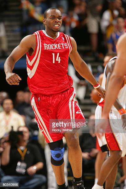 Carl Landry of the Houston Rockets celebrates after a play against the Golden State Warriors on March 21 2008 at Oracle Arena in Oakland California...