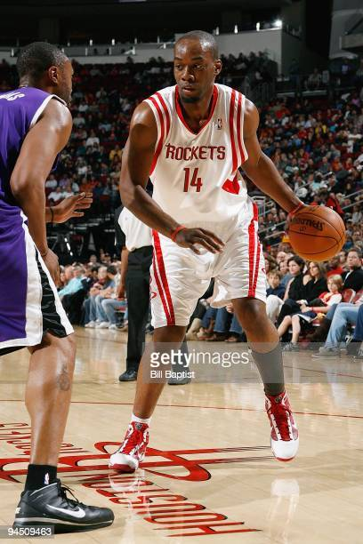 Carl Landry of the Houston Rockets drives the ball against Kenny Thomas of the Sacramento Kings during the game on November 21 2009 at the Toyota...