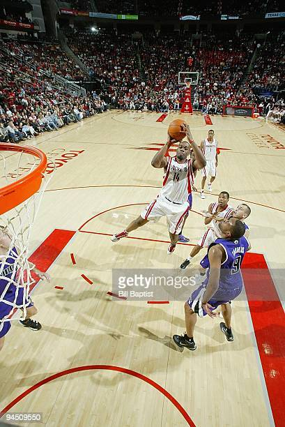 Carl Landry of the Houston Rockets shoots the ball against Kenny Thomas of the Sacramento Kings during the game on November 21 2009 at the Toyota...