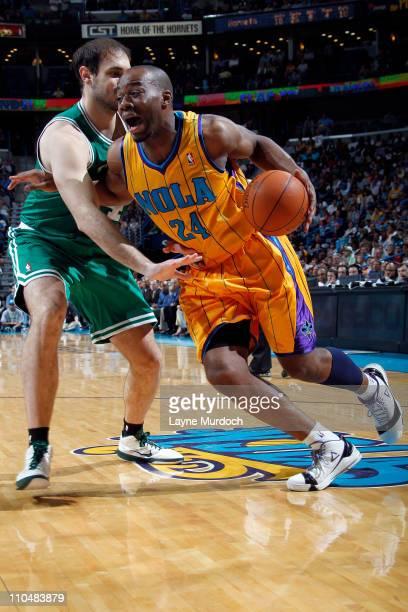 Carl Landry of the New Orleans Hornets drives against Nenad Krstic of the Boston Celtics on March 19 2011 at the New Orleans Arena in New Orleans...