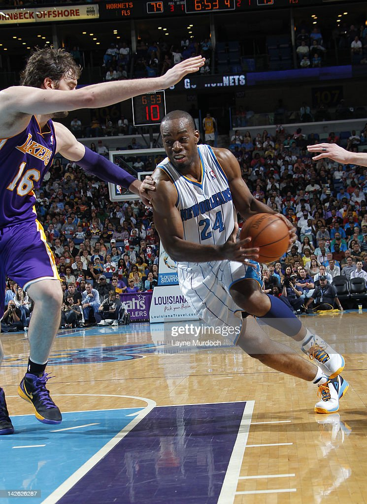 Carl Landry #24 of the New Orleans Hornets drives to the basket against Pau Gasol #16 of the Los Angeles Lakers on April 9, 2012 at the New Orleans Arena in New Orleans, Louisiana.
