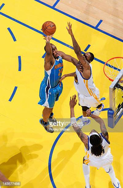 Carl Landry of the New Orleans Hornets puts up a shot over Mickell Gladness of the Golden State Warriors on April 24, 2012 at Oracle Arena in...
