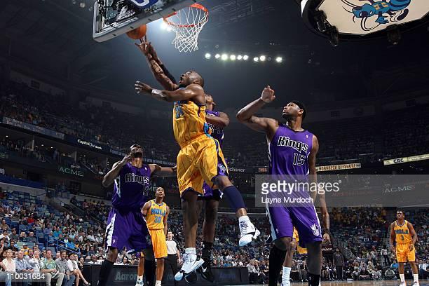 Carl Landry of the New Orleans Hornets shoots against Jason Thompson of the Sacramento Kings on March 12 2011 at the New Orleans Arena in New Orleans...