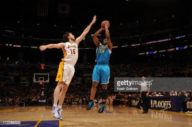 Carl Landry of the New Orleans Hornets shoots against Pau Gasol of the Los Angeles Lakers in Game One of the Western Conference Quarterfinals in the...