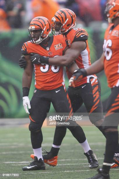 Carl Lawson and Michael Johnson of the Cincinnati Bengals celebrate a defensive stop during their game at Paul Brown Stadium on October 8 2017 in...