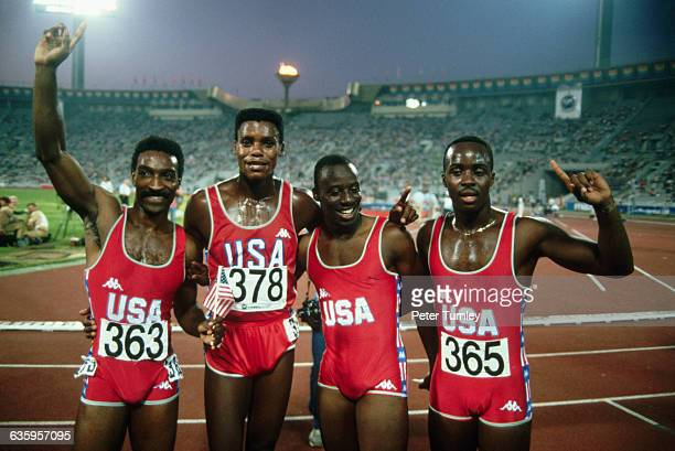 Carl Lewis #378 stands with other members of the United States 4x100 meter hurdle relay team at the 1986 Goodwill Games