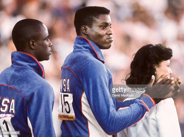 Carl Lewis and Sam Graddy of the USA wait for the medal ceremony of the Men's 100m race of the Track and Field competition of the 1984 Olympic Games...