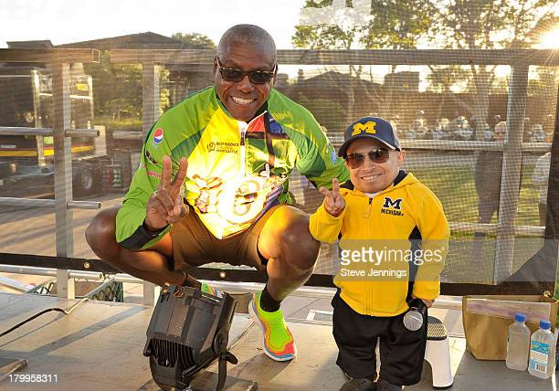 Carl Lewis and Verne Troyer onstage at the 100mile start of the Best Buddies Challenge Hearst Castle Carmel to San Simeon at Hearst Castle on...