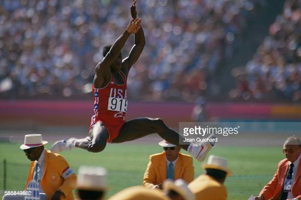 Carl Lewis competes in the long jump during the 1984 Los Angeles Olympic Games