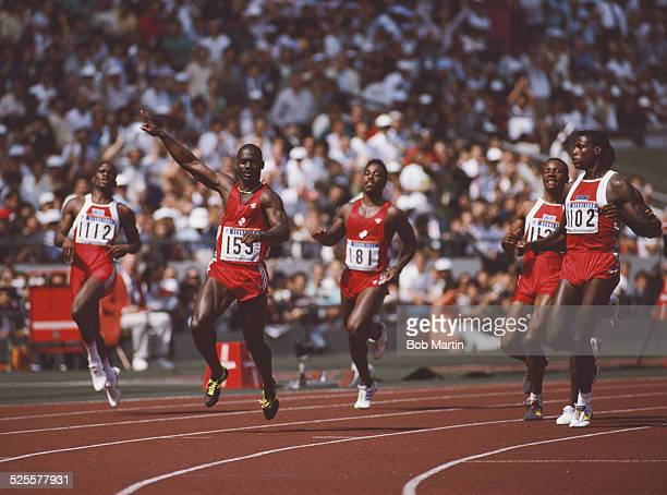 Carl Lewis looks across to Ben Johnson of Canada as he celebrates winning gold in the Men's 100 metres final on 24 September 1988 during the XXIV...