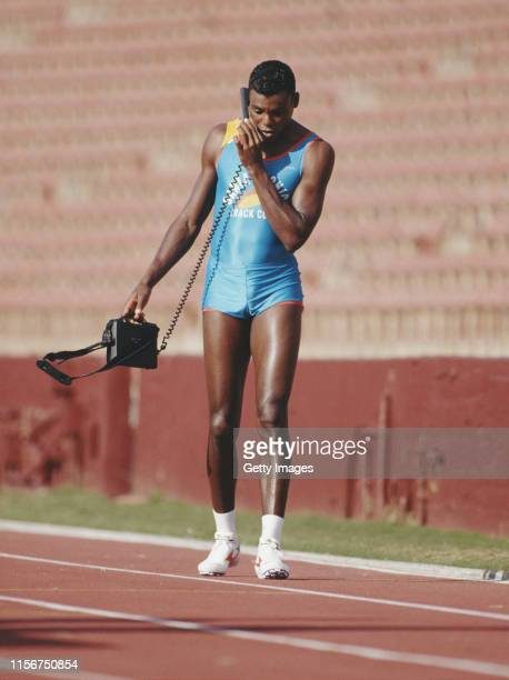 Carl Lewis of the Santa Monica Track Club using a mobile telephone during a training session circa 1992 at the Santa Monica Track Club at Los Angeles...