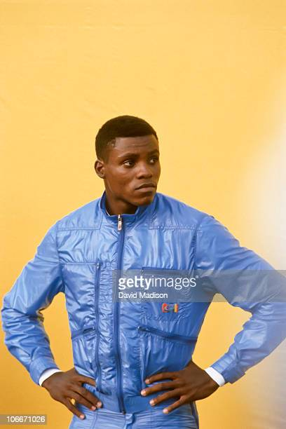 Carl Lewis of the Santa Monica Track Club waits on the awards stand during the 1984 United States Olympic Track and Field Trials at the Los Angeles...