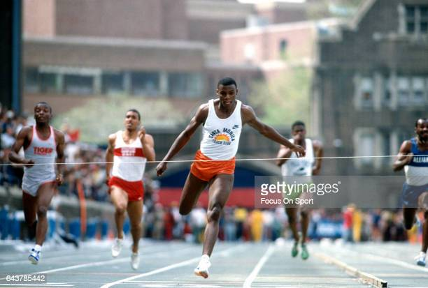 Carl Lewis of the Santa Monica Track Team competes in a 100 meter competition track and field event circa 1984