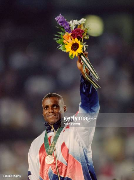 Carl Lewis of the United States celebrates winning the gold medal in Men's Long Jump competition on 29th July 1996 at the XXVI Summer Olympic Games...