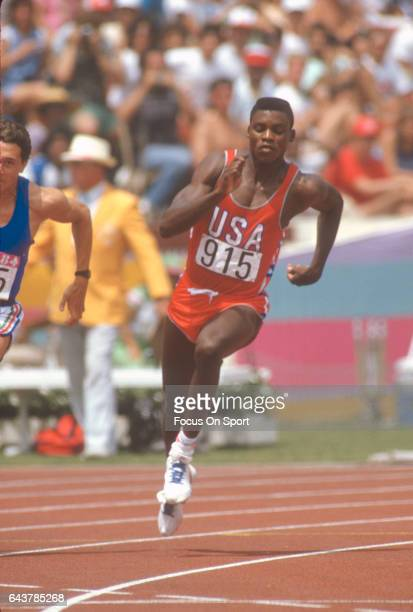 Carl Lewis of the United States competes during the Games of the XXIII Olympiad in the 1984 Summer Olympics circa 1984 at the Los Angeles Memorial...