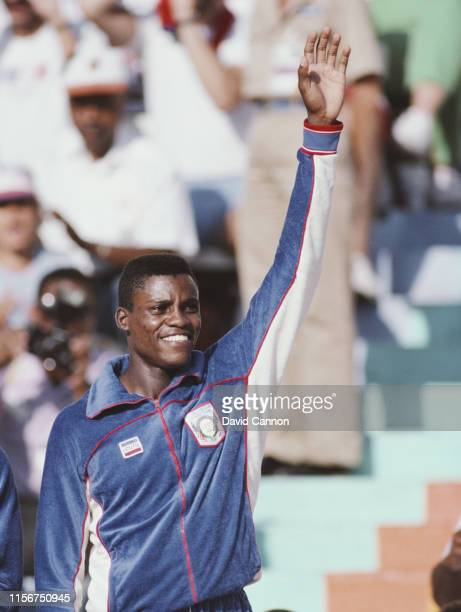 Carl Lewis of the United States stands on the podium to receive his gold medal for winning the Men's 4 x 100m relay metres event at the XXIII Olympic...