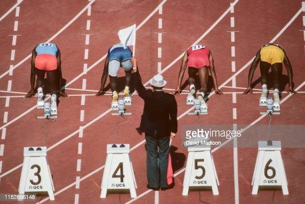 Carl Lewis of the USA and the Santa Monica Track Club prepares to run the quarter final round of the Men's 100 meter event at the 1984 United States...