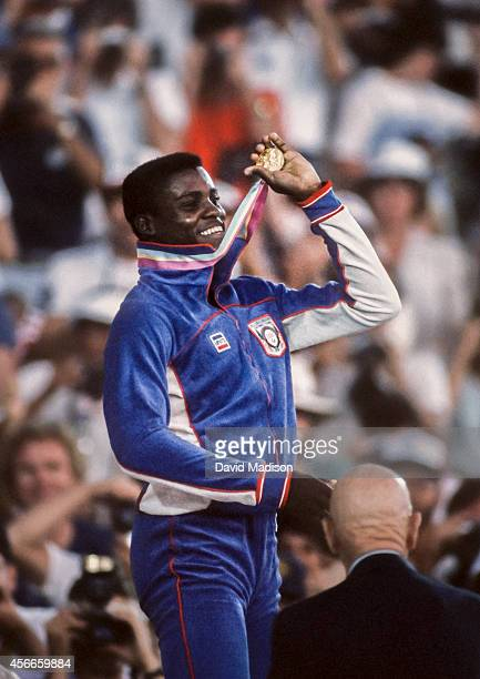 Carl Lewis of the USA celebrates his victory in the Men's 100m race of the Track and Field competition of the 1984 Olympic Games held on August 4...