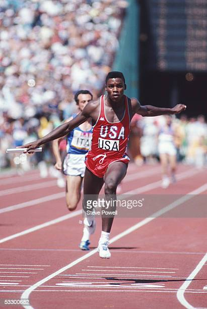 Carl Lewis of the USA crosses the line to anchor the USA team to victory in the 4 x 100m relay during the 1984 Olympic Games at the Colliseum Stadium...
