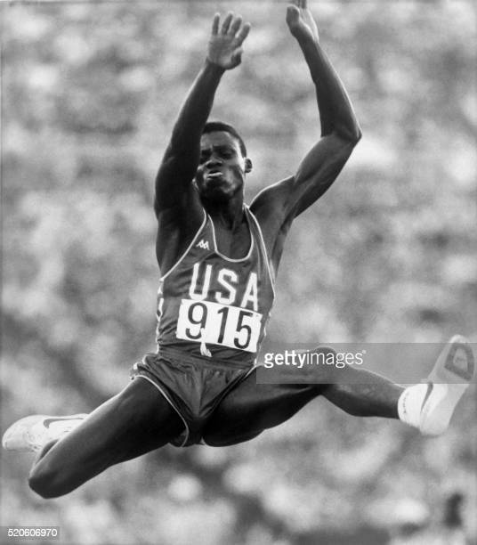 Carl Lewis of the USA flies through the air during the final of the men's Olympic long jump competition on August 06 1984 in Los Angeles Lewis won...