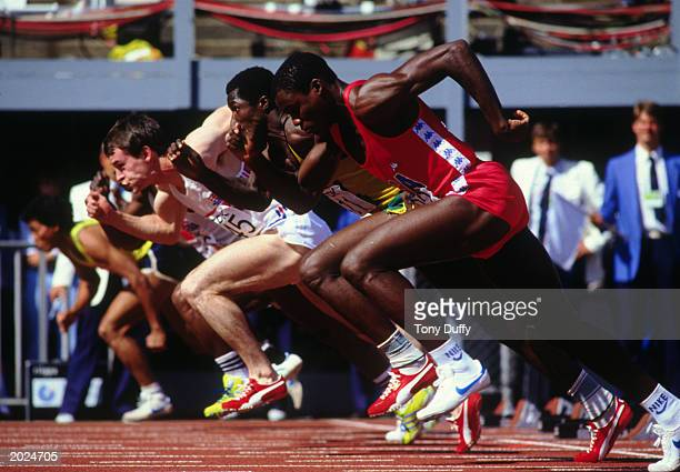 Carl Lewis of the USA races off of the starting blocks during Heat 2 of the Men's 100m race at the IAAF World Championships on August 8 1983 in the...