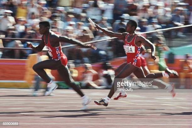 Carl Lewis of the USA receives the baton from team mate Calvin Smith as he anchors the USA team to victory in a new world record time of 3783 seconds...
