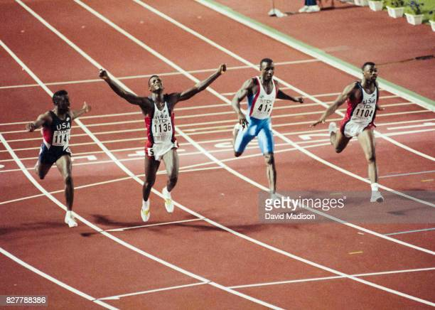 Carl Lewis of the USA runs a World Record time of 986 seconds to win the Men's 100 meter event of the 1991 IAAF World Championships in Athletics held...