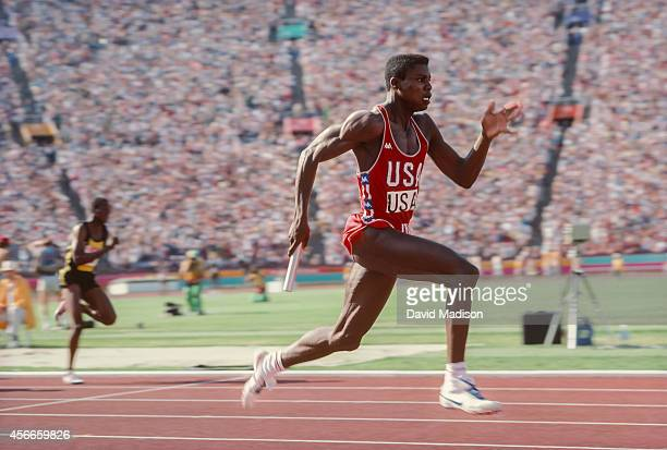 Carl Lewis of the USA runs the anchor leg of the Men's 4x100m relay race of the Track and Field competition of the 1984 Olympic Games held on August...