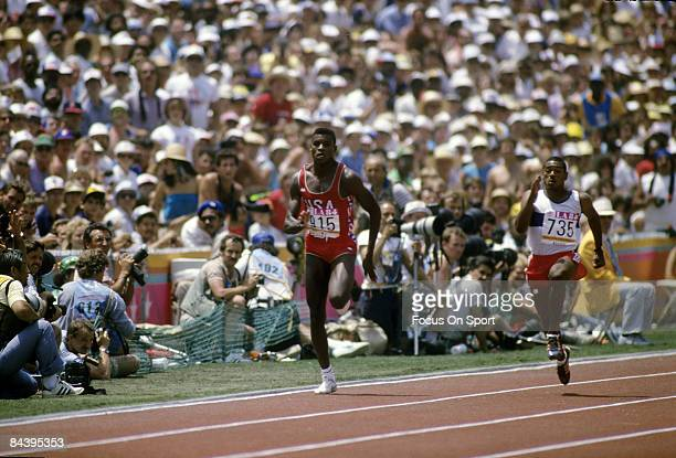 Carl Lewis of the USA Track and Field 1984 Summer Olympic team competes during 200M race in the 1984 summer Olympic games at the Los Angeles Memorial...
