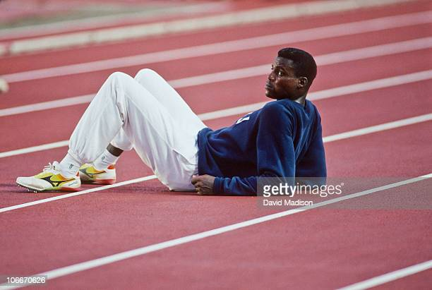 Carl Lewis of the USA waits on the track between rounds of the Men's Long Jump competition of the 1991 IAAF World Championships in Athletics held in...