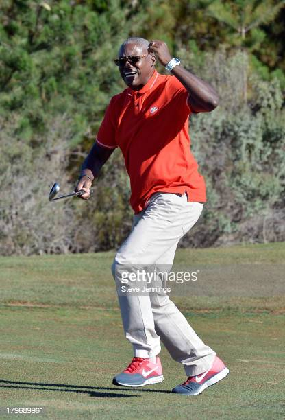 Carl Lewis reacts to his chip shot during the Best Buddies Golf Challenge And Luncheon at Tehama Golf Club on September 6 2013 in Carmel California