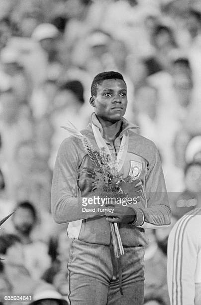Carl Lewis stands with his hand over his heart as the American national anthem is played at the 1984 Summer Olympic Games where Lewis won a total of...