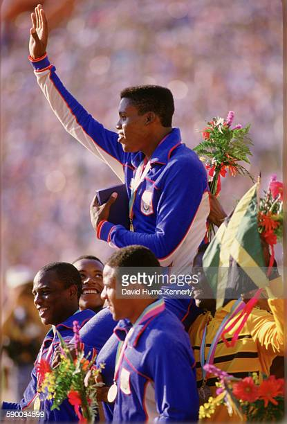 Carl Lewis waves to the crowed while being carried by his teammates and other athletes after team USA won the gold medal for the Men's 4x100m Relay...