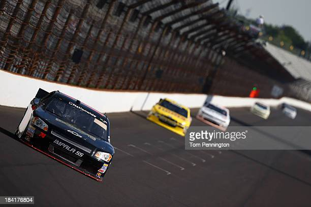 Carl Long driver of the HEAdjusterscom Chevrolet during practice for the NASCAR Nationwide Series Indiana 250 at Indianapolis Motor Speedway on July...