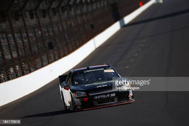 Carl Long drives the HEAdjusterscom Chevrolet during practice for the NASCAR Nationwide Series Indiana 250 at Indianapolis Motor Speedway on July 26...