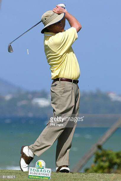 Carl Mason of England watches his tee shot on the scenic 14th hole during the second round of the Tobago Plantations Seniors Classic at the Tobago...