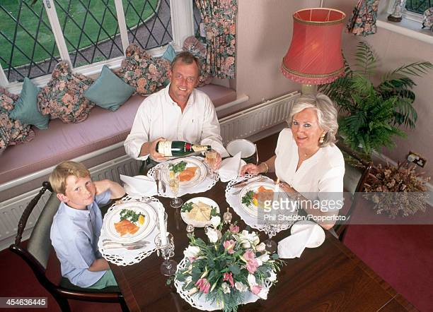 Carl Mason of Great Britain at the dinner table at home with his wife Beryl and their son Andrew circa 1994