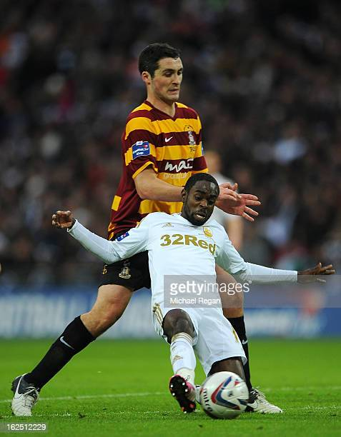 Carl McHugh of Bradford City puts Nathan Dyer of Swansea City under pressure during the Capital One Cup Final match between Bradford City and Swansea...
