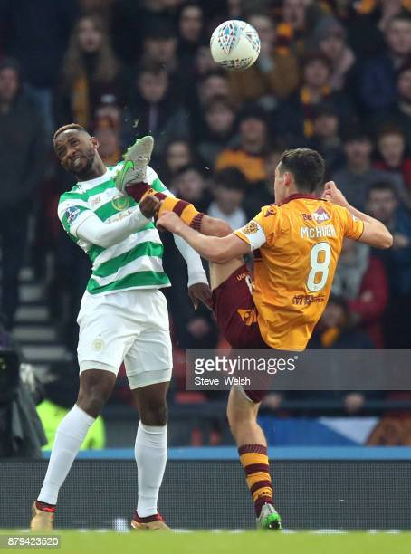 Carl McHugh of Motherwell goes high on Moussa Dembele of Celtic during the Betfred Cup Final at Hampden Park on November 26 2017 in Glasgow Scotland