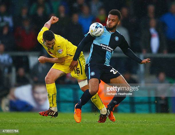 Carl McHugh of Plymouth Argyle and Aaron Holloway of Wycombe Wanderers battle for the ball during the Sky Bet League Two Playoff semi final match...