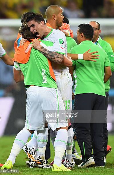 Carl Medjani of Algeria celebrates with teammates after a 11 draw during the 2014 FIFA World Cup Brazil Group H match between Algeria and Russia at...