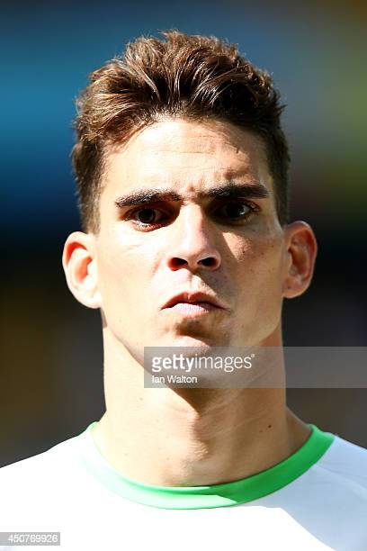Carl Medjani of Algeria looks on during the National Anthems prior to the 2014 FIFA World Cup Brazil Group H match between Belgium and Algeria at...